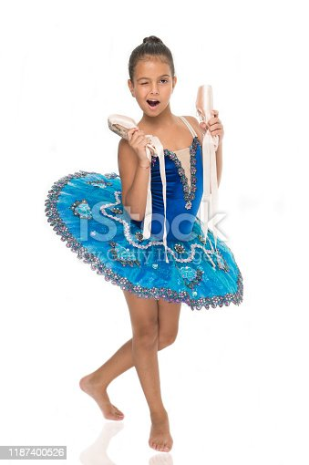 istock There are many paths to ballet. Child happy holds ballet shoes important attribute excellent ballerina. Start career classic dances program. Girl ballerina holds pointe shoes in hand white background 1187400526