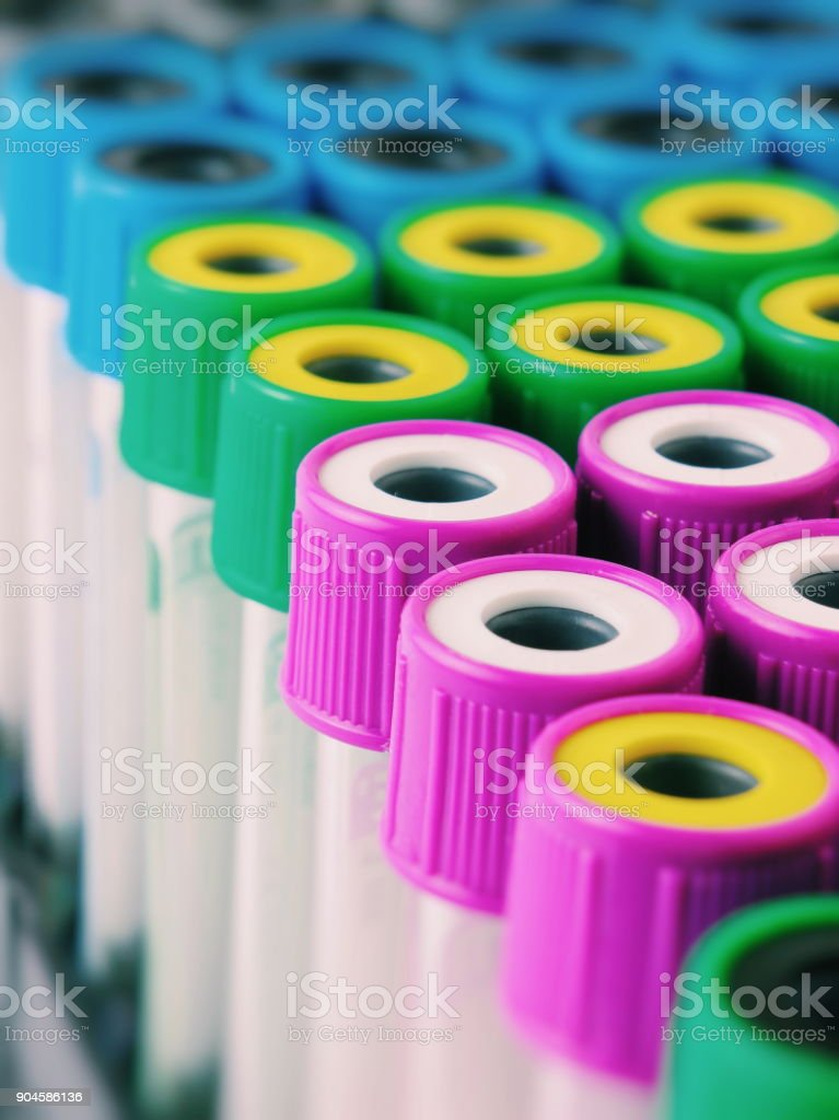 There are many Test Tubes with multicolor lids on the Test Tube rack....