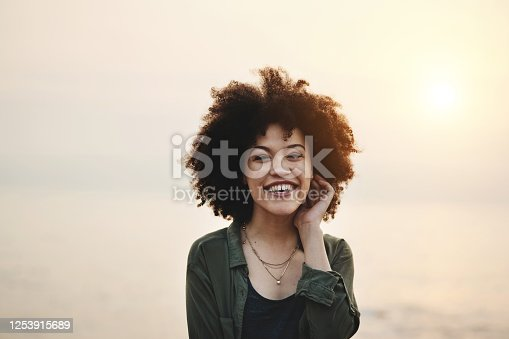 Portrait of a cheerful young woman standing outdoors