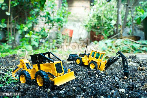 Trucks and bulldozers to clear the garden to refurbish