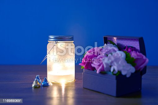Lanterns, Wooden Table, Plastic Flower Basket, Chocolate