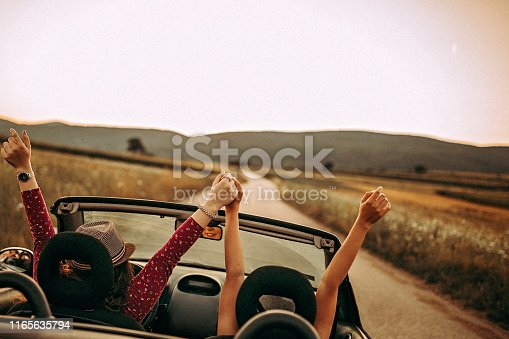 Two girls riding in convertible