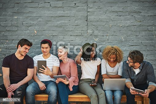 Shot of a diverse group of people social networking outside