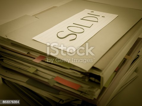 istock There is the huge pile of business documents on the desk. 853376354
