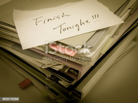 istock There is the huge pile of business documents on the desk. 853376356