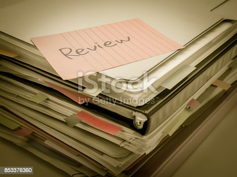 istock There is the huge pile of business documents on the desk. 853376360