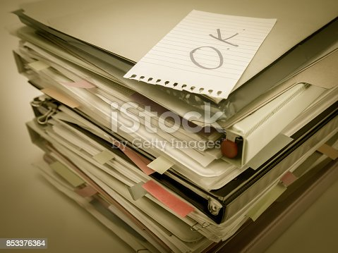 istock There is the huge pile of business documents on the desk. 853376364