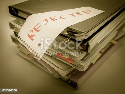 istock There is the huge pile of business documents on the desk. 853376376