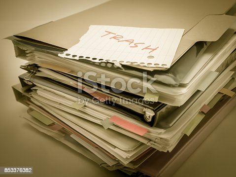 istock There is the huge pile of business documents on the desk. 853376382