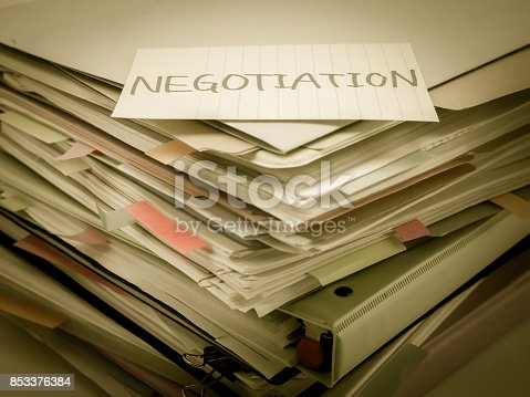 istock There is the huge pile of business documents on the desk. 853376384