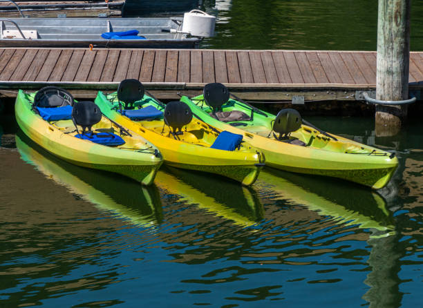 There kayaks at dock stock photo