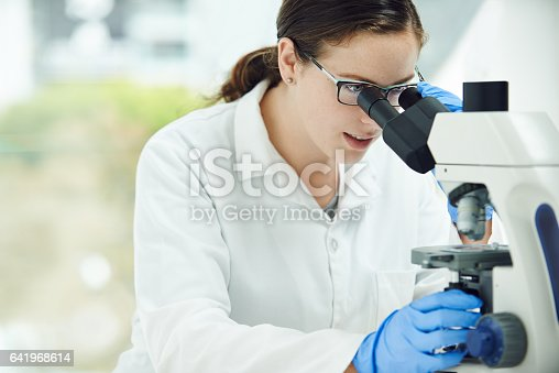 Shot of a young scientist working in a lab
