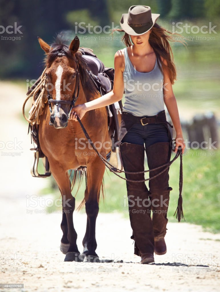 There's a strong bond between rider and horse stock photo