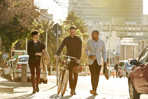 Full length shot of three businesspeople on their way to work