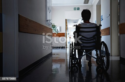Rearview shot of a senior woman sitting in a wheelchair