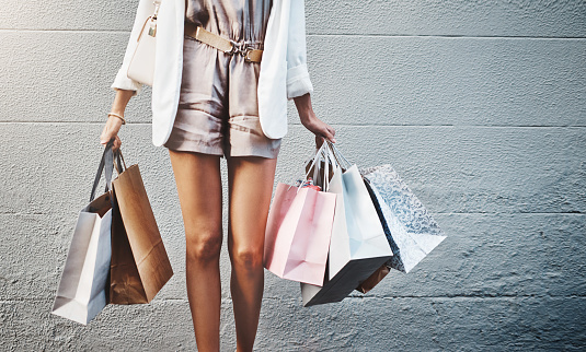 Cropped shot of an unrecognizable woman out shopping in the city