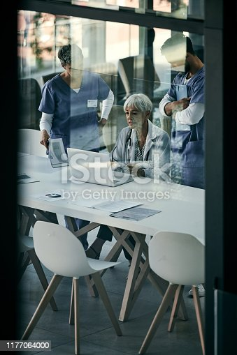Shot of a group of medical professionals having a meeting together inside a boardroom at a hospital