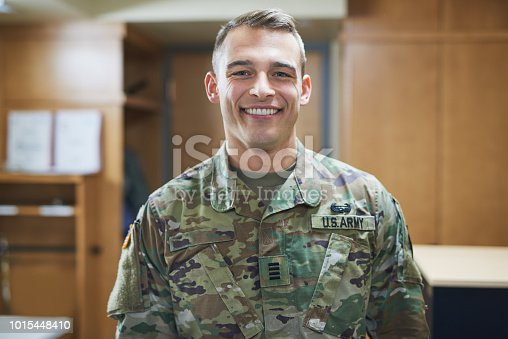 Shot of a young soldier standing in the dorms of a military academy