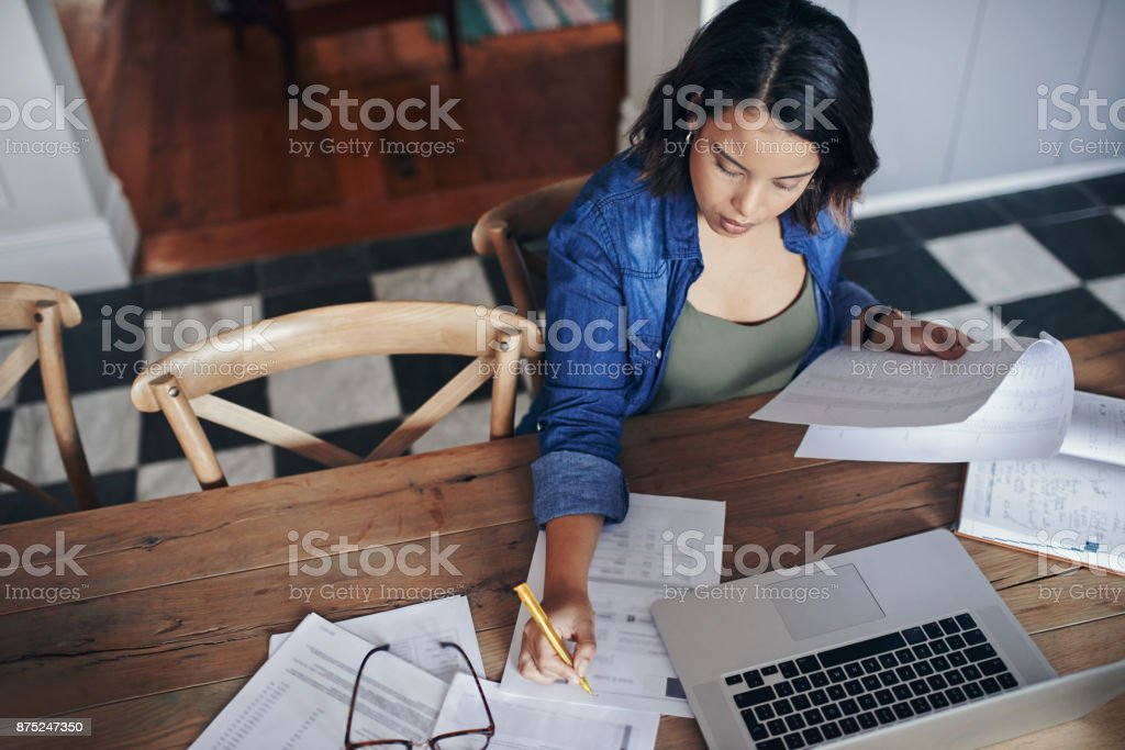 There's lots to do but she'll get it done stock photo
