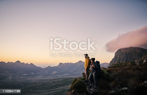 Shot of a young couple out mountain climbing together