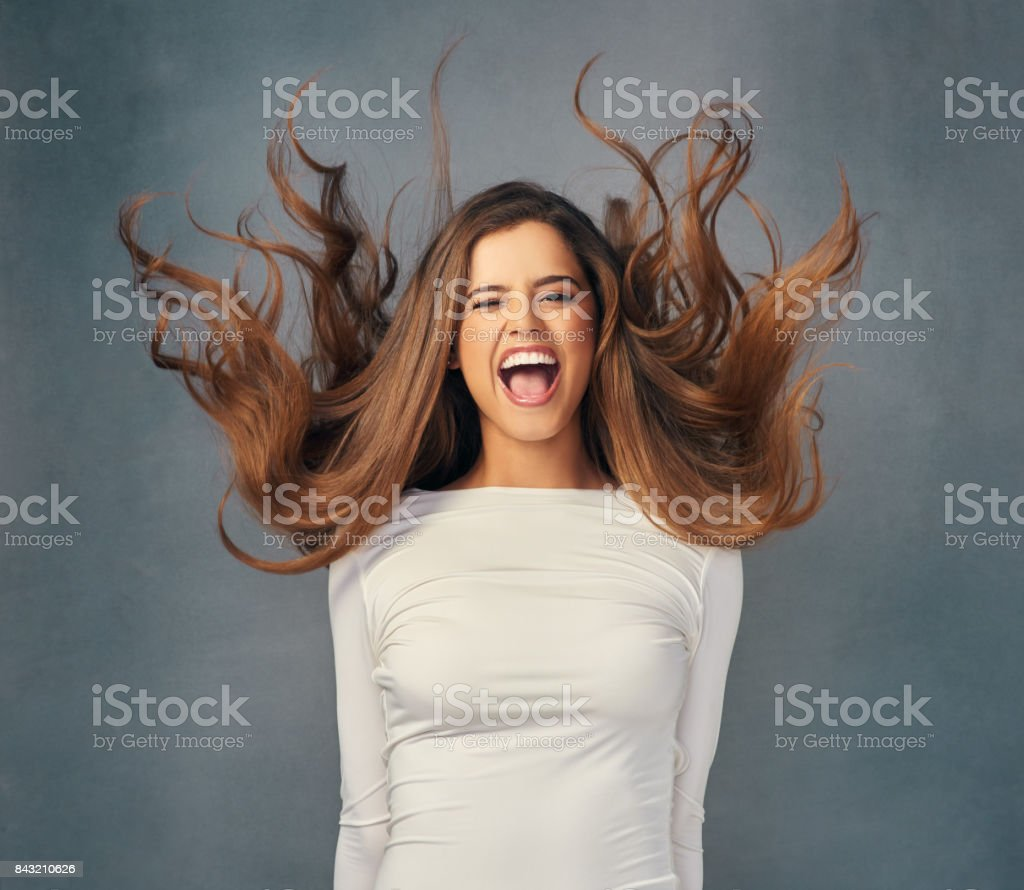 There's no turning down the volume of her glorious hair stock photo