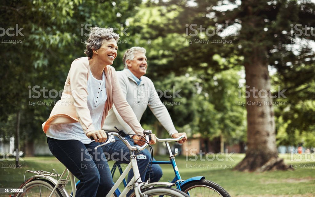 There's nothing better than enjoying a bike ride together stock photo