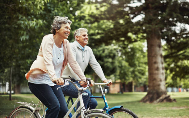 there's nothing better than enjoying a bike ride together - cycling stock photos and pictures