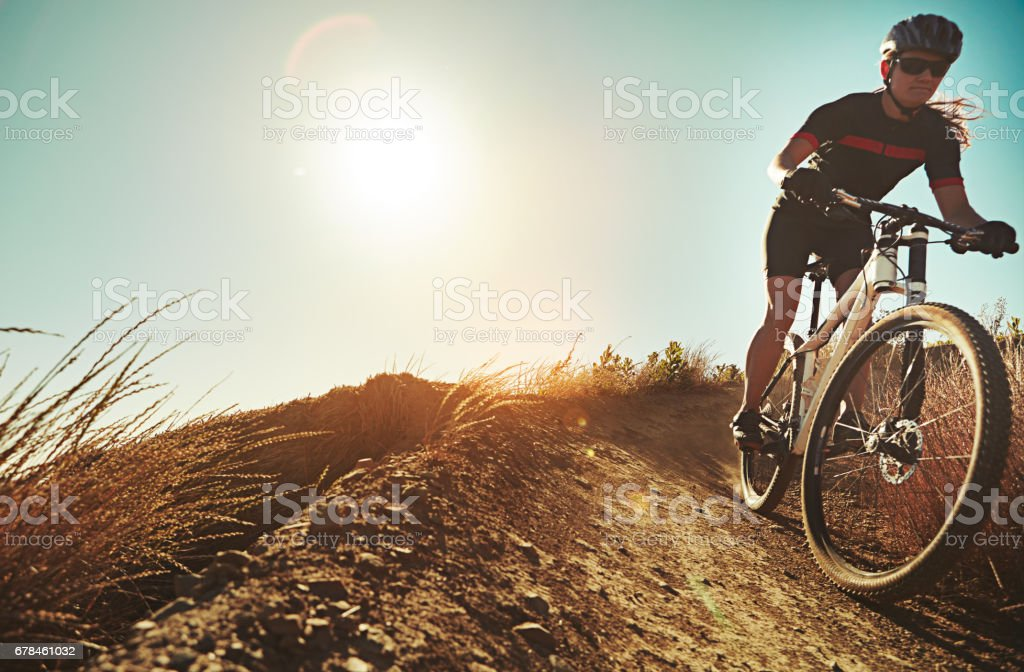 There's nothing like the feeling of flying down a trail stock photo