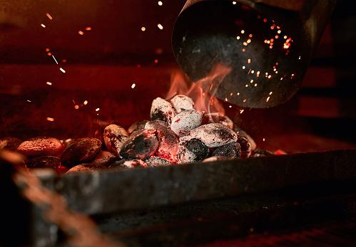 Closeup shot of charcoal burning in a fireplace