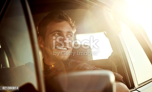 Shot of a handsome young man enjoying a roadtrip