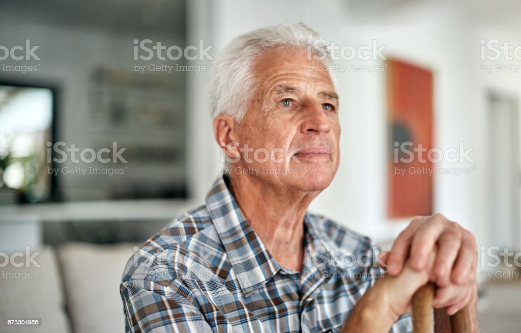 There's so much to be thankful for Shot of a senior man sitting at home 50-59 Years Stock Photo