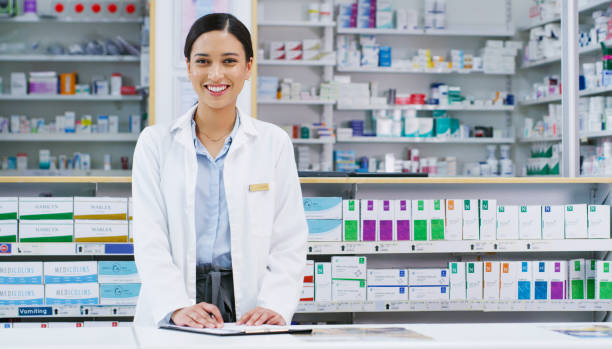 There's sure to be a treatment around here for you Portrait of a young pharmacist writing notes while working in a chemist pharmacy stock pictures, royalty-free photos & images