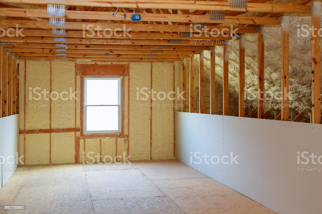 thermal and hidro insulation with spray foam at house construction stock photo