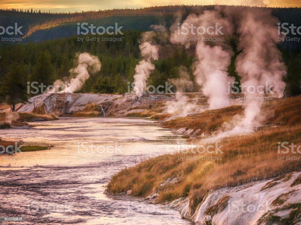 Thermal hot springs and geyser basin along the Firehole River, Yellowstone National Park, Wyoming, USA. stock photo