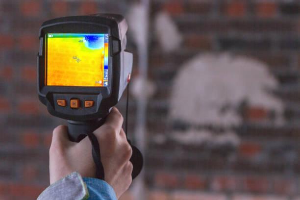 Thermal Image of Heat Leak through Windows stock photo