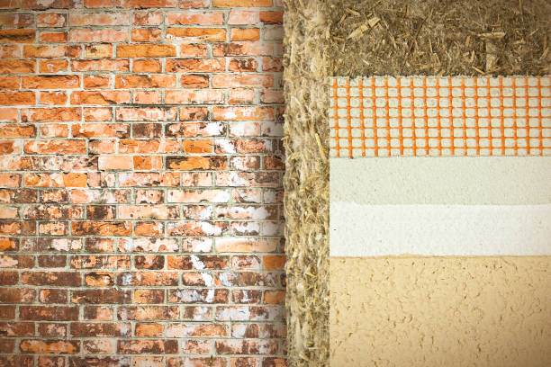 Thermal insulation coatings with hemp for building energy efficiency and reduce thermal losses against a brick wall - Building energy efficiency and savings concept image with copy space stock photo