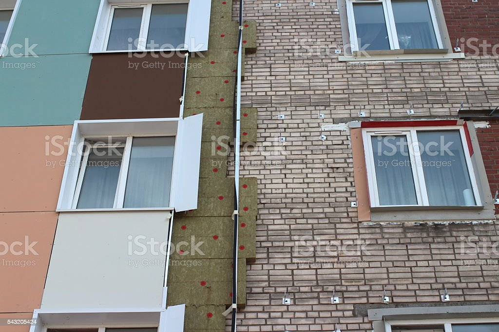Thermal insulation of a house wall stock photo