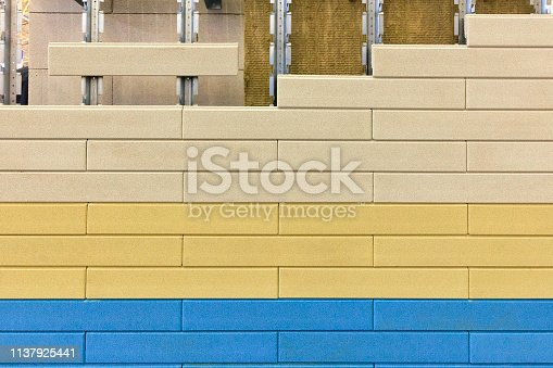 istock Thermal insulation of mineral wool walls under multi-colored siding. Insulation for siding. 1137925441