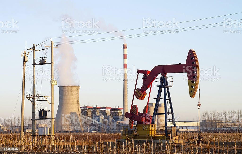 Thermal power plant and pumpjack royalty-free stock photo