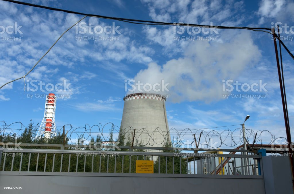 Thermal power plant behind a fence stock photo