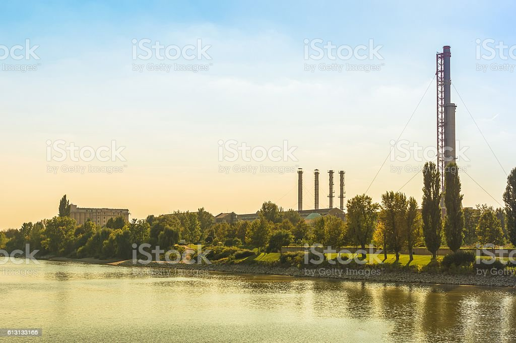 Thermal power plant with trees and blue sky stock photo