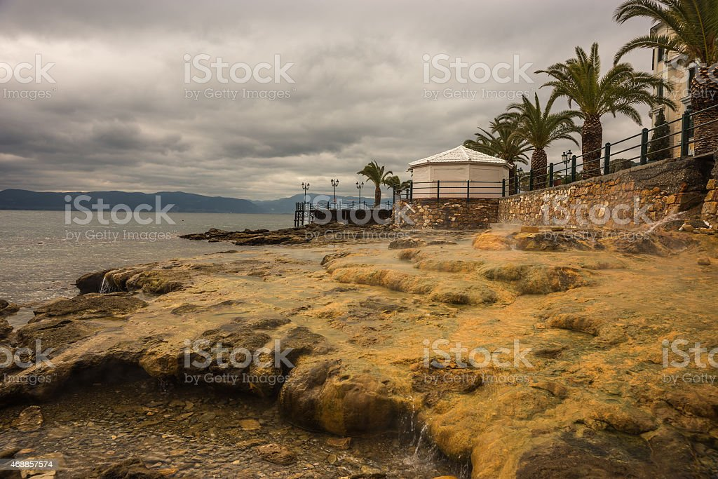 Thermal springs on the beach in Loutra Edipsou, Evia, Greece stock photo