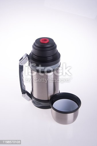1135476970 istock photo Thermo or Thermo flask on background 1198570103