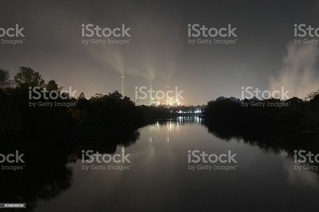 Thermoelectric power plant river night stock photo