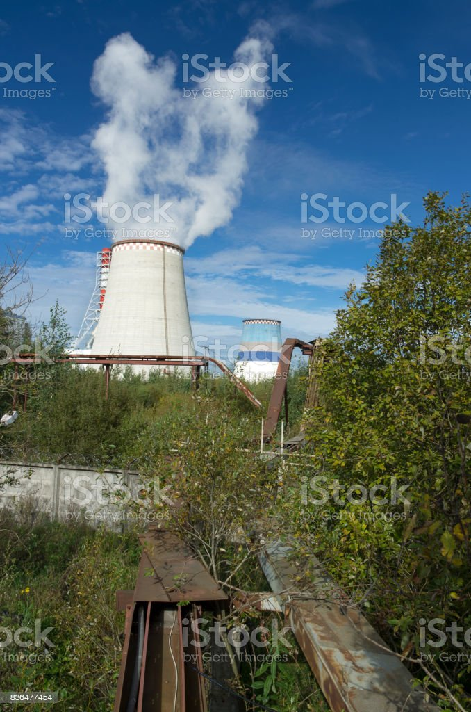 Thermoelectric power station with smoke pipe stock photo