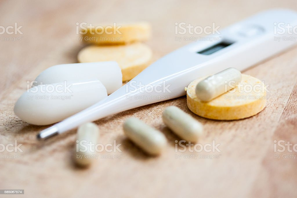 Thermometer and pills stock photo