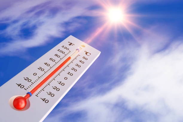 thermometer and sun stock photo