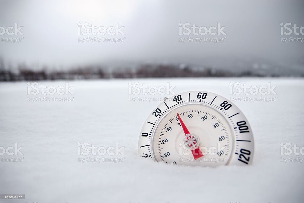 Thermometer in Desolate Winter Snow Tundra royalty-free stock photo