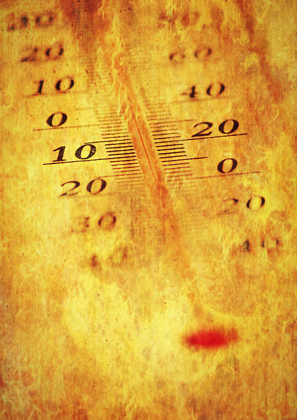 Thermometer in fire stock photo
