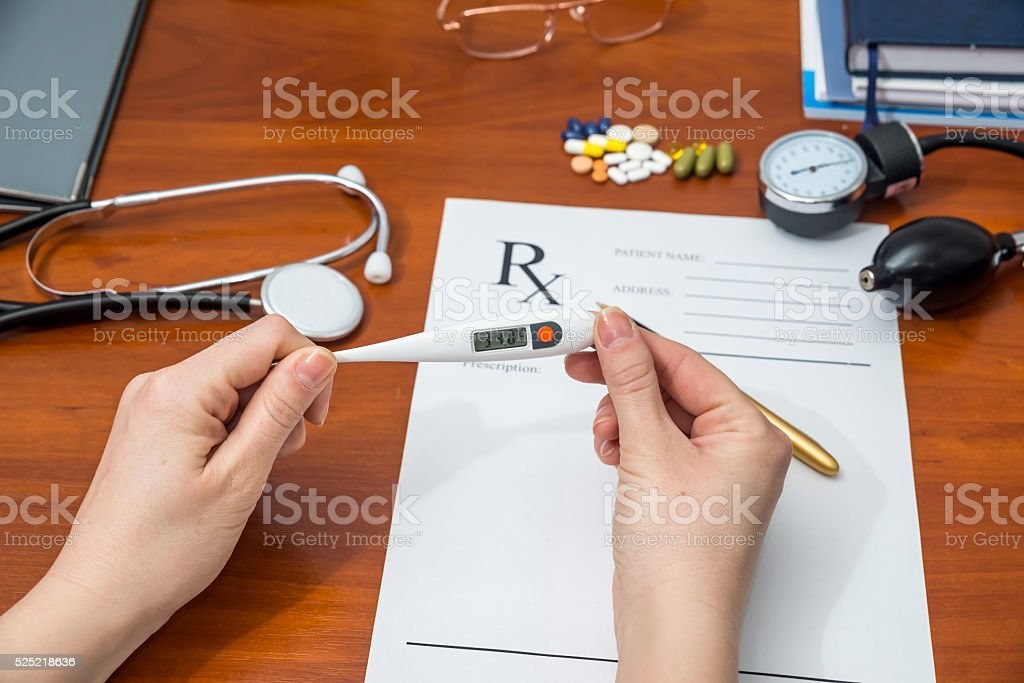 thermometer in hands of doctor on a background form RX stock photo